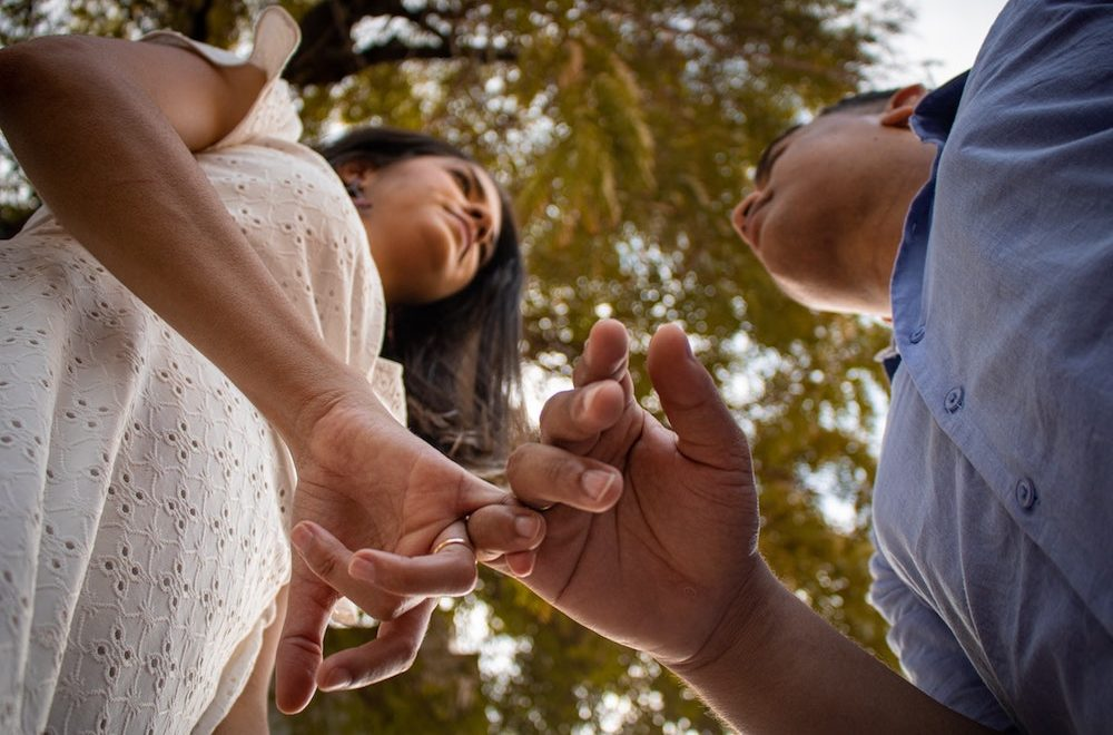 Close up of girl and boy making a pinky swear