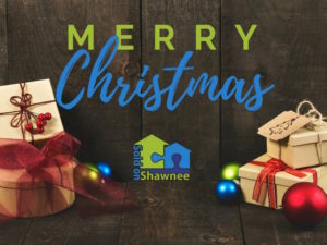 Merry Christmas from Sold on Shawnee Real Estate on rustic wood paneling