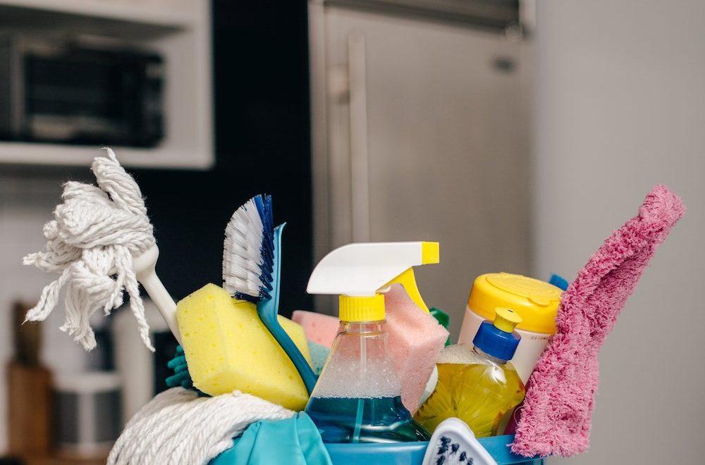 cleaning supplies in bucket in kitchen