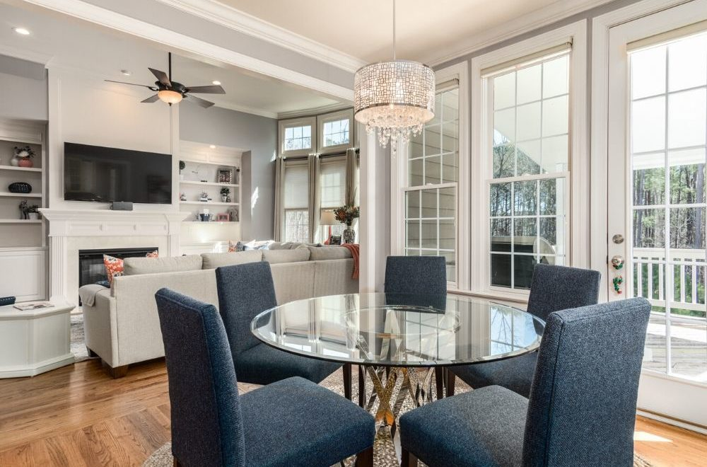 beautifully staged dining room/living room ready for showings