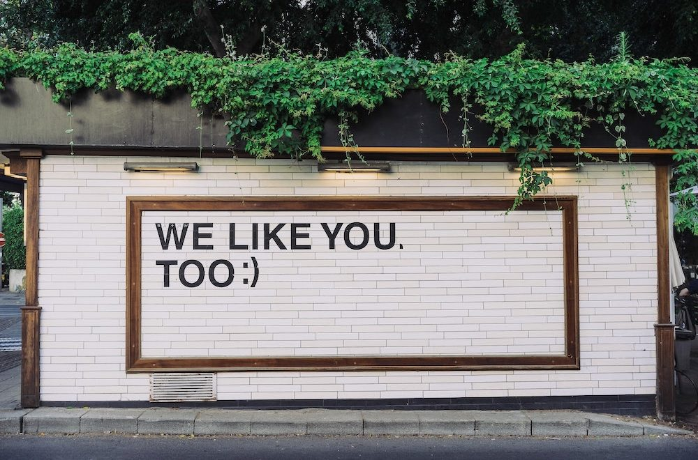 "wall with the message on it, ""WE LIKE YOU, TOO :)"""
