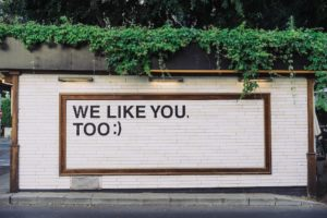 """wall with the message on it, """"WE LIKE YOU, TOO :)"""""""
